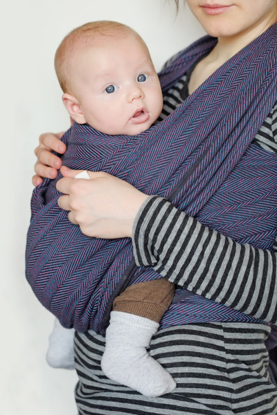 In A Baby Carrier