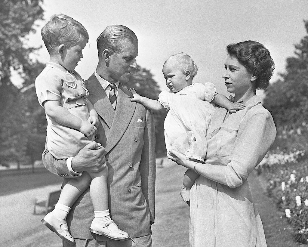 Princess Elizabeth with her husband, Prince Phillip, and children, Prince Charles and Princess Anne. Both children are dressed in looks similar to what the royal babies wear to this day.