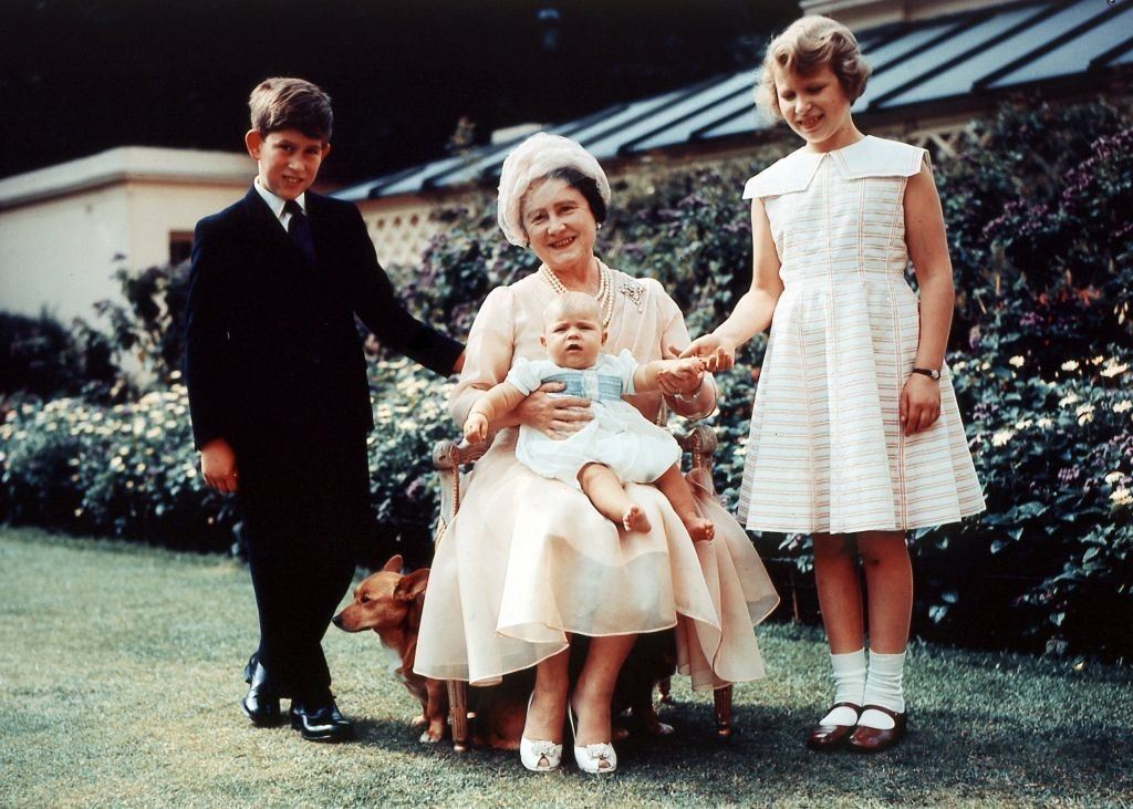 Queen Mother Elizabeth with grandchildren, Prince Charles, Prince Andrew, and Princess Anne. Both Prince Charles and Princess Anne have more modern looks as older children.